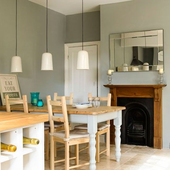 Country Style Dining Area With Pendant Light Trio