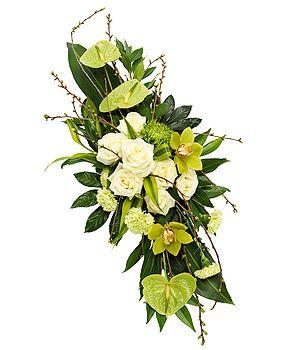 Fleurs deuil : gerbes et coussins actualisés. Le nouveau style floral funéraire se base sur un graphisme épuré et sur la dimension symbolique de la fleur.