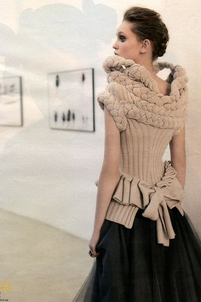 Elegant and graceful sculptural fashion knitwear design with a braided collar and pleated bow back, Gaetano Navarra