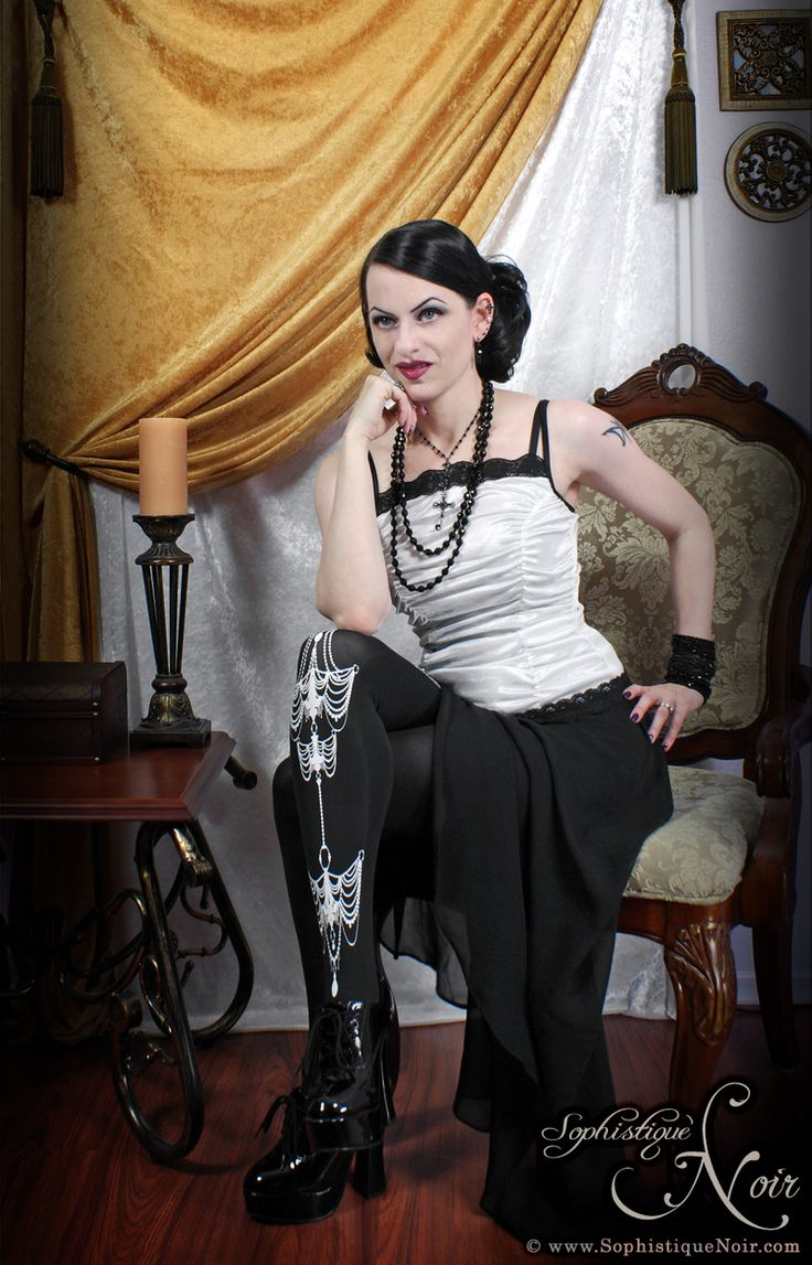 Miss Kitty from sophistiquenoir.com blog rocking our Chandelier Tights. Get 'em on www.theasockalypse.com!