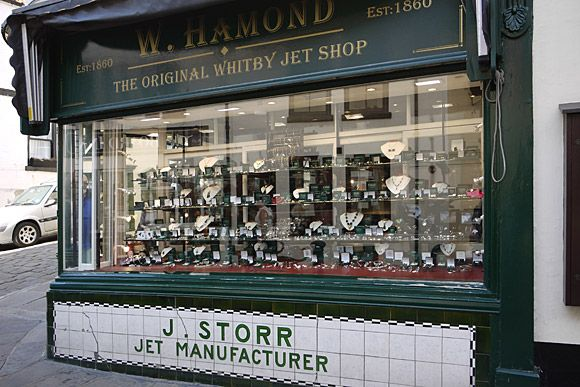 Whitby, Yorkshire, UK shops.  W Hammond, 'the original Whitby Jet Shop.'    Whitby jet is a local, semi-precious stone created from fossilised wood, that can be polished to create shiny black artefacts (hence the phrase 'jet black').