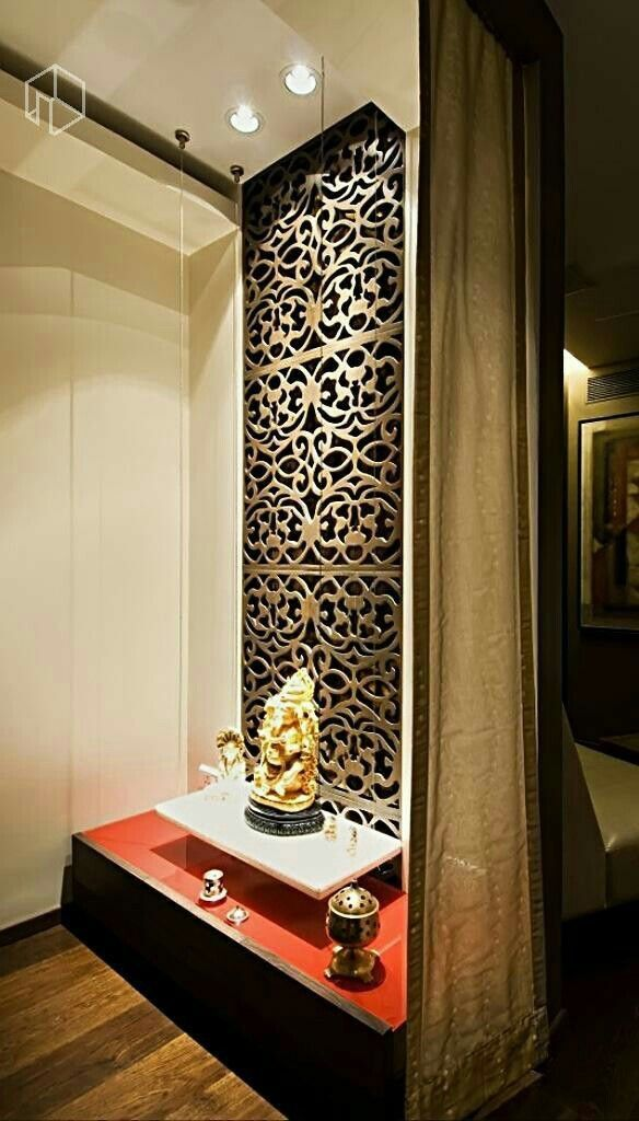 Stunning jali or laser cut design + floating shelf + focus lighting = A divine pooja corner