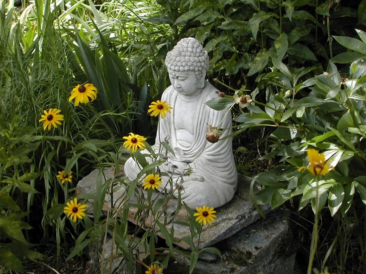 this is how i 39 d like to set my buddha statue in my garden sitting serenely on the rocks. Black Bedroom Furniture Sets. Home Design Ideas