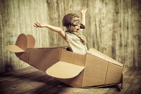 Cute Dreamer Boy Playing with a Cardboard Airplane. Childhood. Fantasy, Imagination. Retro Style. Photographic Print by…