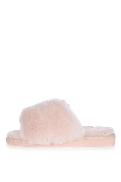 Opt for ultimate comfort around the house in these pale pink sheepskin slider slippers. Wear with a onesie to take cosy to the next level. #Topshop