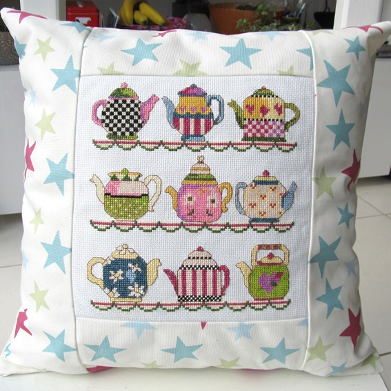 Sew White cushion with cross stitch tea pots.