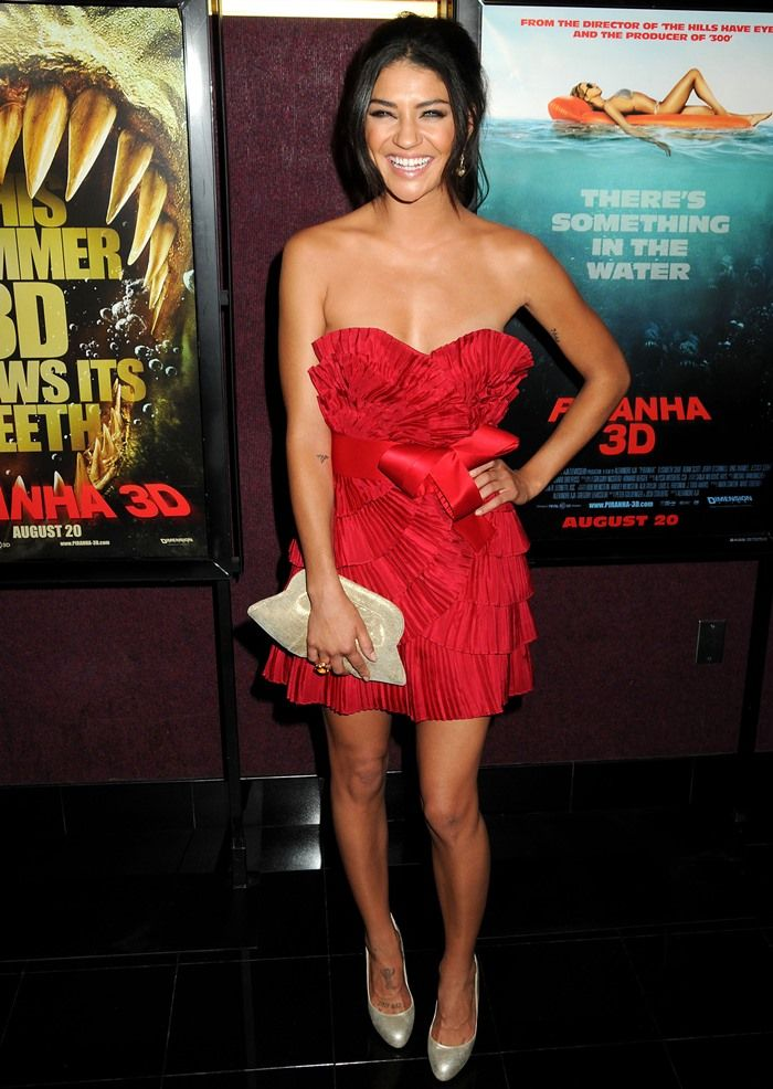 Jessica Szohr wearing a ruby red Notte by Marchesa dress with metallic gold pumps by Aldo