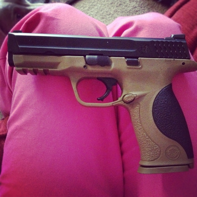 Smith n Wesson M & P 40    And I'm also doing this paint job. That way it'll match my AR 15- Baby.