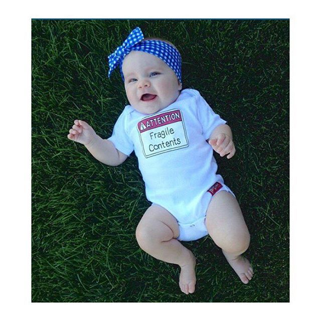 Attention: Fragile Contents!  Just take it! Take in all that cuteness!   I could look at her ALL day!! ⚠️Shop our link in Bio⚠️ Bow & Baby by @fiercelyfreeco #headband #handmade #hazardbabyclothing #onesies #funnybaby #funnybabyonesies #funnyonesies #cutebaby #cute #toddler #toddlertshirts #kidstees #trendykids #trendykiddies #dad #momlife #coffee #newparents #grandparents #babybib #babyhumor #babyshower #babyshowergift #fun #mom #babyfashion #toddlerstyle #igbabystore