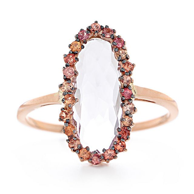 Suzanne Kalan, ring available at Greenwich Jewelers.     Details: light colored Amethyst surrounded by sapphires, 14k gold.