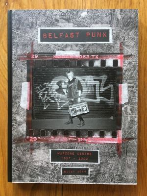 Belfast Punk - Adams, Ricky Damiani, First edition first impression large format hardback in new condition, flat signed by author to endpage, no markings, this is a brand new book, please see pics, PayPal accepted, any questions please get in touch.