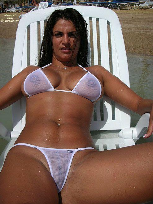 White Bikini Brunette On A Sun Lounger In The Sea