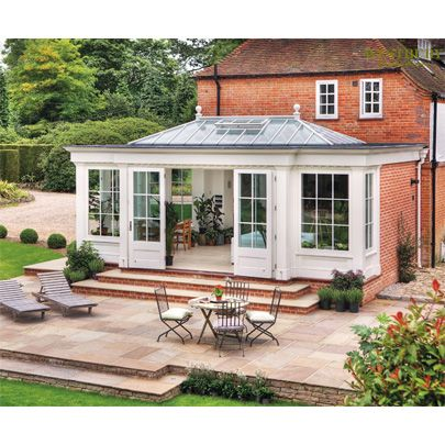 Timber orangery sympathetically designed to suit period property