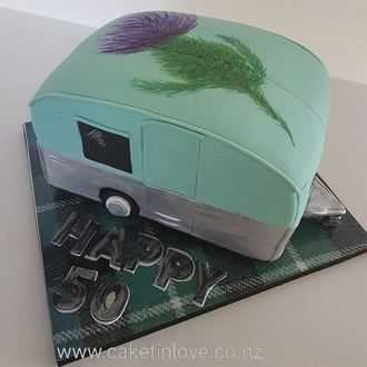 1950's chocolate caravan cake with the Scottish thistle and his clan's tartan on the board. He is also doing up a old caravan so this cake was perfect for him.   #cakesnorthland  #1950s    #caravan  #cakeswhangarei  #chocolatecake  #caketinlove