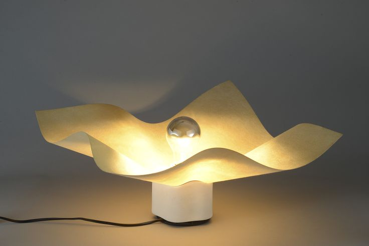 Artemide, 'Area' 10 cm lamp by Mario Bellini, Italy 1974.Table lamp with Rosenthal porcelain base and Cocoon diffuser. E27  light bulb base with mirrored topped surface, height 10cm. Given mention by the Compasso d'Oro in 1979. References: Repertorio 1950/1980 by Giuliana Gramigna, Mondadori p. 408.