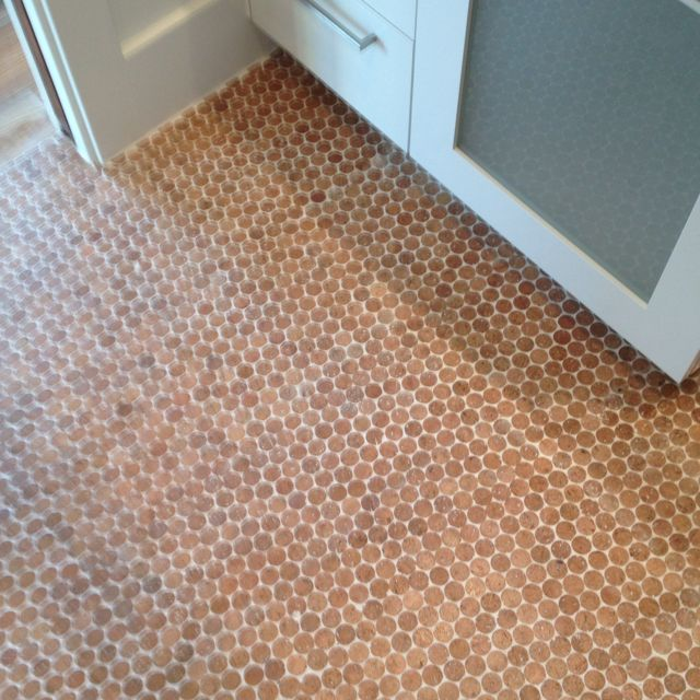 Recycled cork floor--great idea for laundry room.