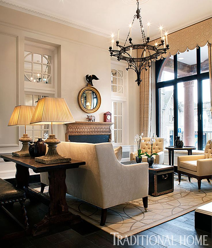 Cream ivory seating pieces, glowing walls, and  sumptuous window treatments create a romantic neutral space.