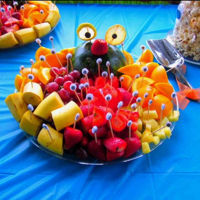 Monster fruit platter. Healthy kids party food. Looks like toothpicks with wiggle eye glued onto it.