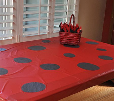 ladybug party table- spots are construction paper glued down