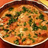 African Chicken in spicy peanut sauce.  Made this tonght...it's really good.  Served with steamed jasmine rice