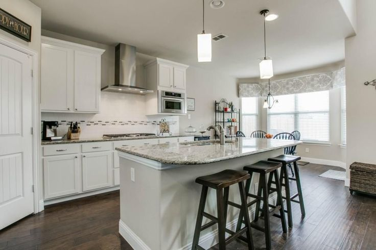 White open kitchen light granite white cabinetry for Open kitchen island with seating