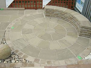 2.8m Indian Sandstone Circle with seating incorporated into the outer circle.