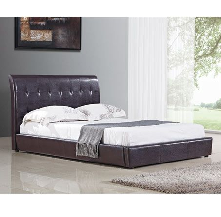 Harmony Beds Siena 4FT 6 Double Leather Bedstead This attractive frame mixes angles with curves to create an intriguing original look. For those who want something a bit different in their bedroom This bed has a sprung slatted base and is available  http://www.comparestoreprices.co.uk/bedsteads/harmony-beds-siena-4ft-6-double-leather-bedstead.asp