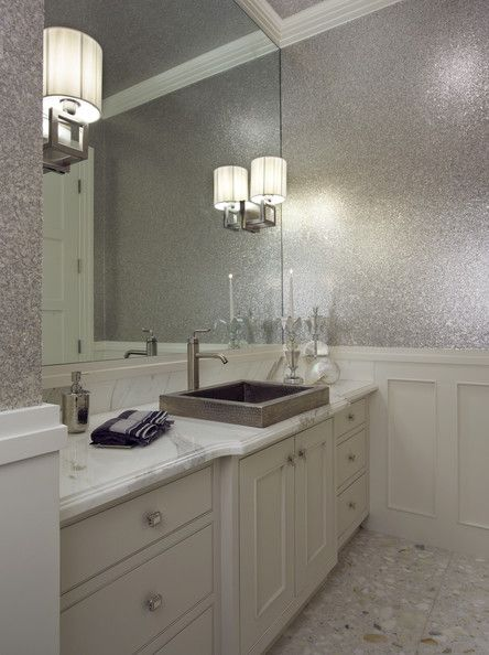 I hate the wall sconces, sink, and facet; I love everything else, especially the glitter wallpaper.