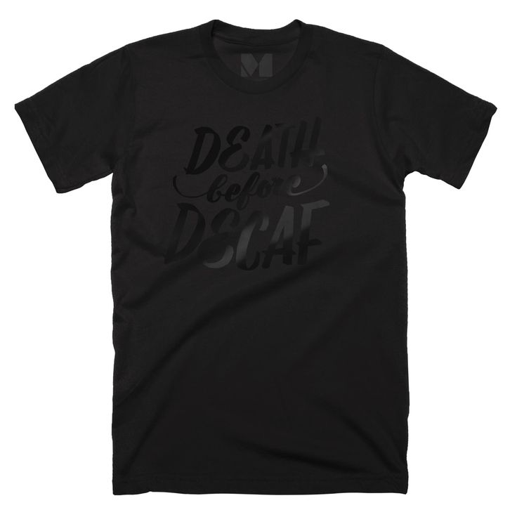 It's Black Friday, and we're celebrating by making special black-on-black editions of 8 of our all-time favorites. Jen Mussari's Death Before Decaf is back in black foil on a black poly-cotton tee (with a custom Death Before Decaf size tag).