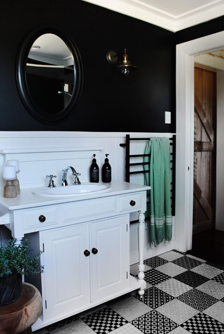 Bungalow Renovation. White and black bathroom by Auckland designer Hayley from Lou Brown Design.