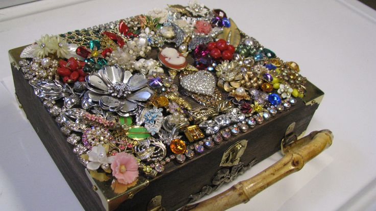 Old vintage jewelry on a cigar box...a great way to craft forward your mother's/grandmother's jewelry by Crafty Grammy