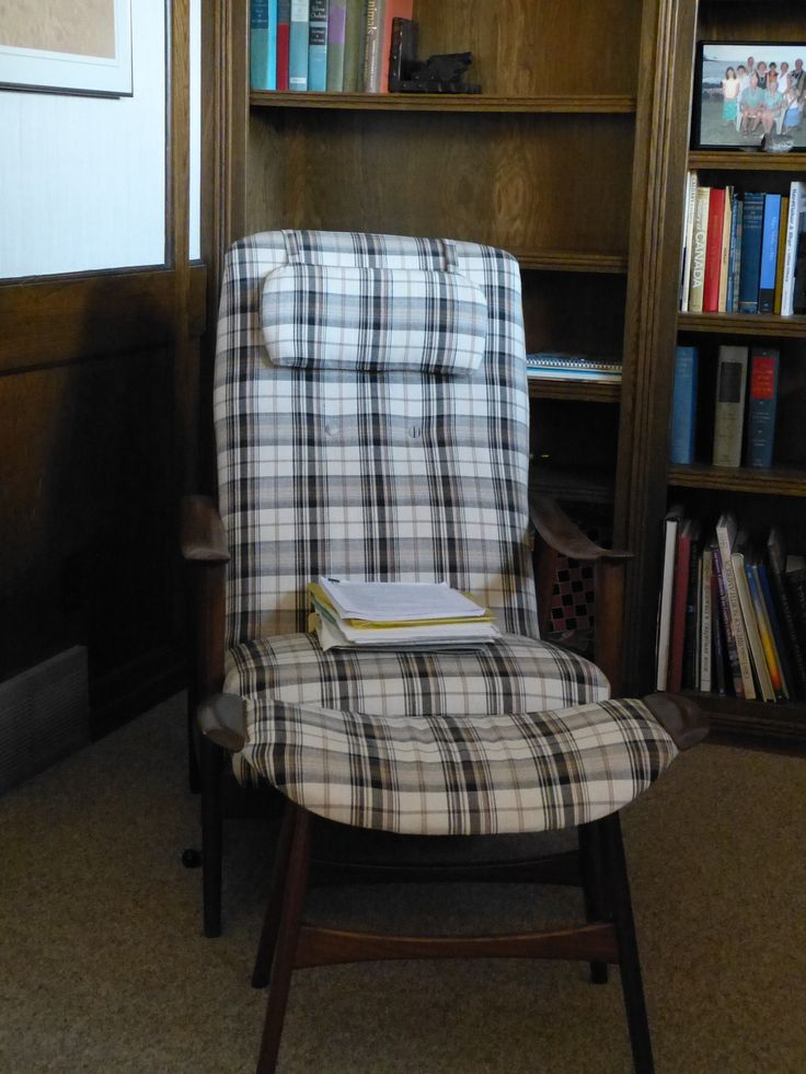 1960s Teak Lounge (tall) chair and foot stool - teak is dark and chair has been re-covered.