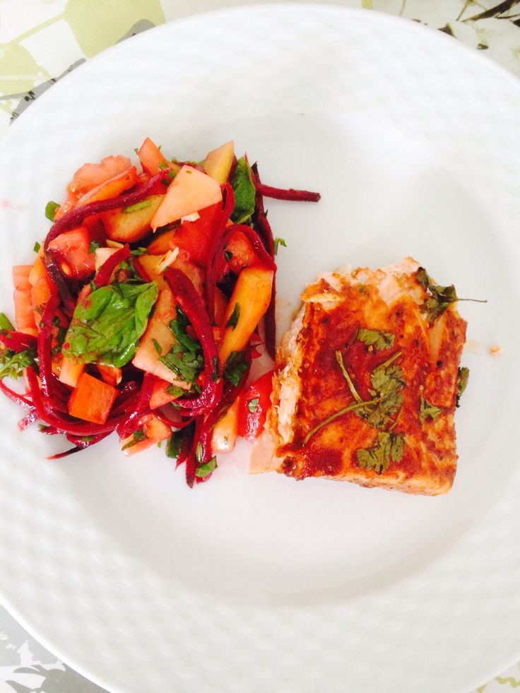 Colorful salad with grilled salmon