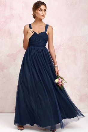 We'll make dress shopping as easy as we can for you with the Sunday Kind of Love Navy Blue Tulle Gown! You won't believe how gorgeous this maxi dress is in real life, with layers of tulle wrapping a padded sweetheart bodice (with shoulder straps), and expanding into a voluminous full skirt. Wear it as-is, or customize to your heart's desire! Hidden back zipper/clasp.