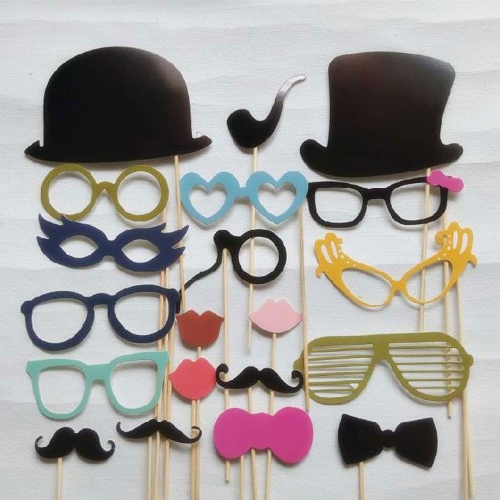 Assorted pack of photo booth props. Props include mustaches, hats, lips, glasses, etc. on sticks for hand held use. Great for weddings or parties. 20 pieces per package.