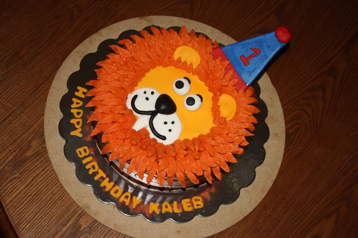 Lion Head Cake - This was for a friends little boys 1st birthday. The face is made with fondant and mane is buttercream. Smaller cake is his smash cake.