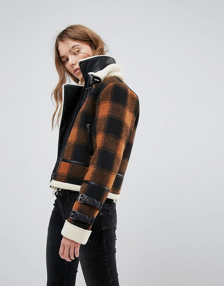 the cropped plaid jacket with shearling detail is the perfect winter addition to young women's wardrobe to create a edgy winter outfit