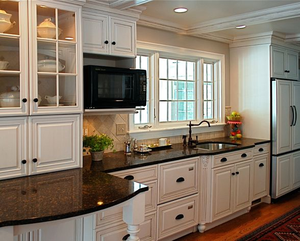 white cabinets dark countertop counter in front of appliance garage glass doors echo window - Columbia Kitchen Cabinets