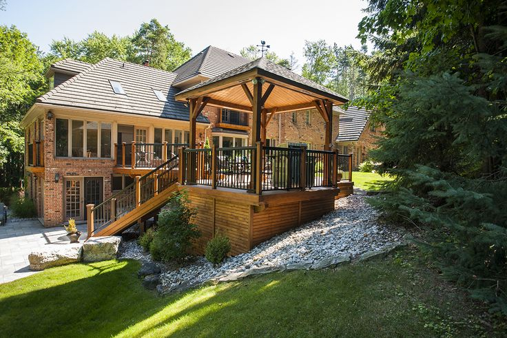 This custom design deck by Hickory Dickory Decks was built using Armadillo decking and trimmed in cedar.