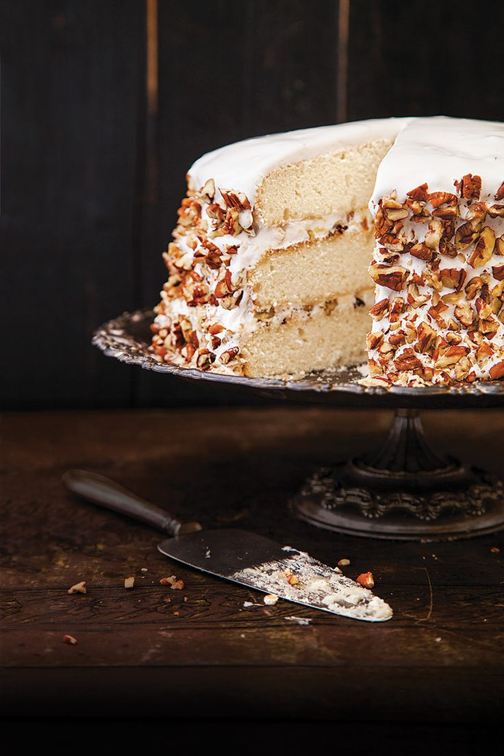 From SAVEUR Issue #168 A traditional Southern confection, this regal dessert gained popularity through writer Owen Wister's 1906 romance novel, Lady Baltimore. Three dreamy white layers of cake are infused with rose water and slathered with an Italian meringue frosting studded with pecans, raisins, dried figs, and candied orange peel.