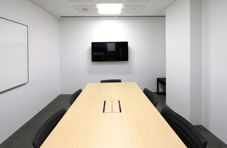 CMS provided AV wall bracket for the TV and some executive on-desk box for power solutions in this boardroom environment.