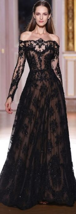 Wow! Stunning black lace, long sleeve, floor length gown. This would look amazing in white for my wedding!!