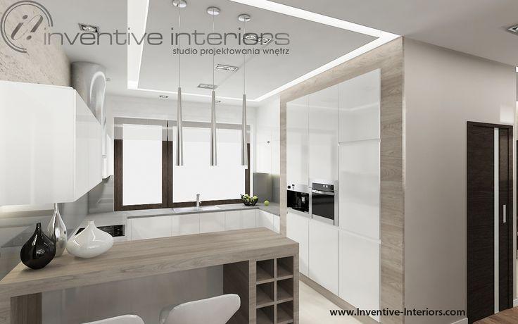Projekt kuchni Inventive Interiors - biel i drewno w otwartej kuchni