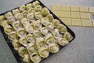 Uszka — pierogi-like Polish dumplings served with red borscht