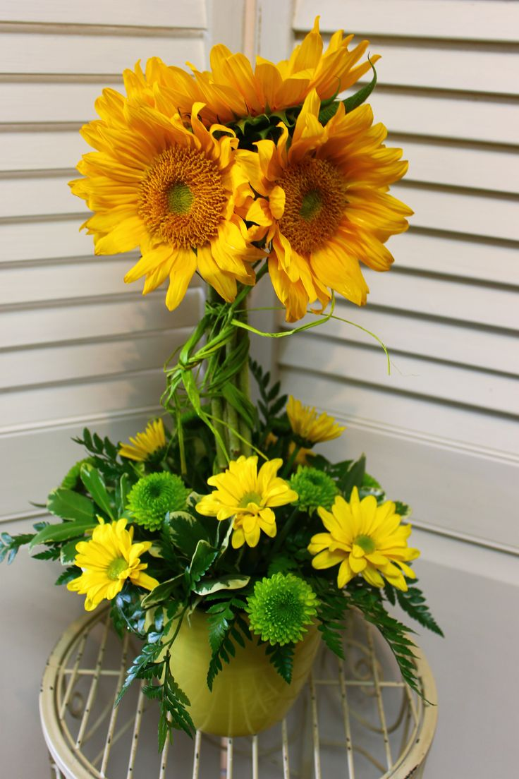 A unique bouquet of sunshine starting at $35! Stop in or call now, our information is in our bio.