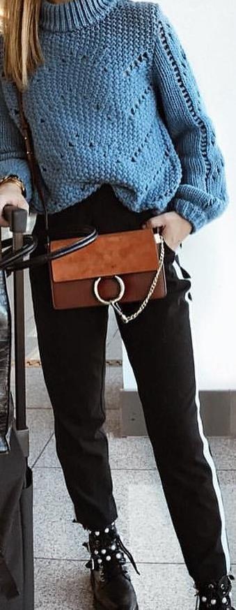 brown envelope suede shoulder bag and blue knit turtle-neck sweate
