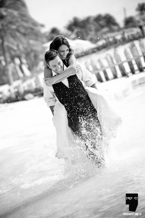 Isla Mujeres + Trash the dress session + destination honeymoon México . ocean + beach + dress + wet + fun wedding photos