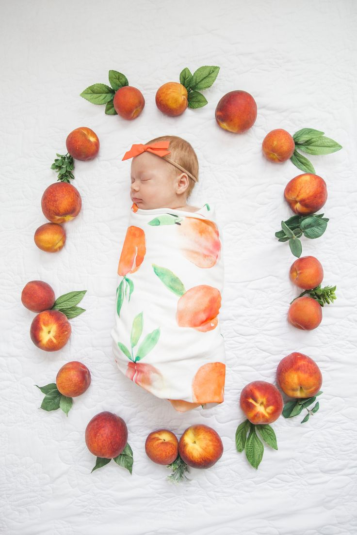 The best newborn photo idea ever! Make a wreath out of fresh peaches, paired with the swaddle from By George! Baby Boutique: https://www.etsy.com/listing/386156238/organic-cotton-swaddle-blanket-in-sweet?ref=shop_home_feat_3