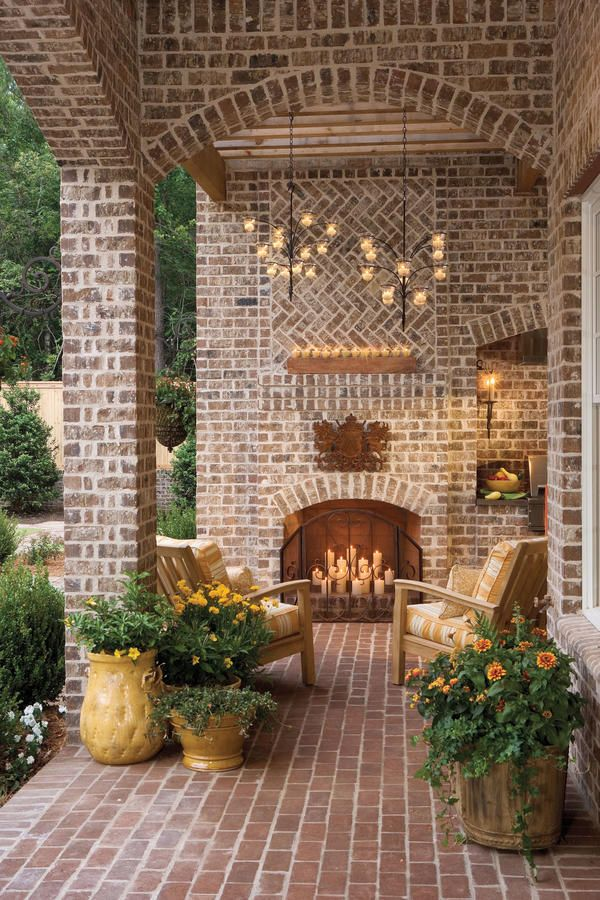 For year-round lounging, this enclosed sitting area boasts candle chandeliers and a fireplace. Filling the fireplace with candles instead of firewood is a great idea for adding light and charm in warm summer months.  Choosing Your Porch Style