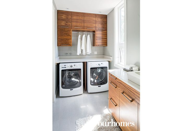 The cabinetry in the laundry room is consistent with the kitchen. http://www.ourhomes.ca/articles/build/article/uptown-rebuild-catalyzes-neighbourhood-change?full=true#sthash.qnbcxpPy.dpuf